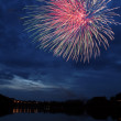 Fireworks Over Lake at Night - Stock Photo