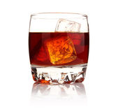 Glass of whiskey with ice cubes isolated — Stock Photo
