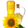 Jug and bottle of sunflower oil with flower isolated — Stock Photo