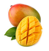 Fresh mango fruit with cut and green leafs isolated — ストック写真