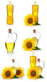 Set of bottles anfd jugs of sunflower oil with flowers isolated — Stock Photo