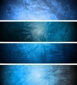 Set di sfondi materici blu — Vettoriale Stock