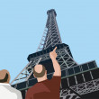 Rear view of tourists pointing towards eiffel tower — Stock Photo