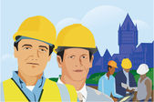 Construction workers with architectural buildings in background — Stock Photo