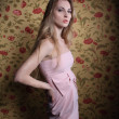 Portrait of the beauty girl in pink dress - Stock Photo