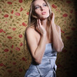 Beauty young blond girl in silver dress - Stock Photo
