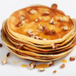 Delicious pancakes with honey and walnuts — Stock Photo