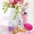 Vintage perfume bottles and flowers — Stock Photo #5556848