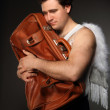 Mr. Angel with brown bag - Stock Photo