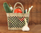Still life with basket of vegetables — Stock Photo