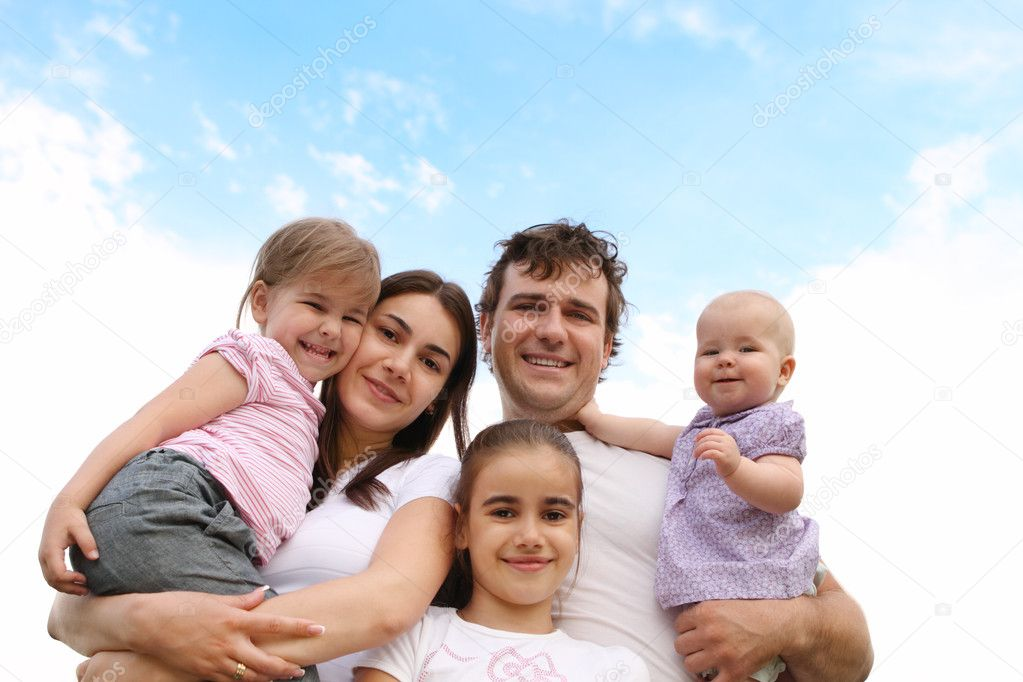 Happy young family with three daughters outdoors  Stock Photo #5851831