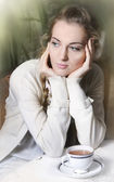 Young blond girl in cafe — Stock Photo