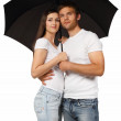Portrait of a young couple with umbrella — Stock Photo