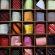Ties on the shelf - Stock Photo