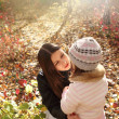Two sisters in autumn forest — Stock Photo #6201277