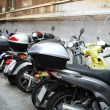 Italian street with parked motorcycles - Stock Photo
