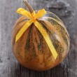 Royalty-Free Stock Photo: Pumpkin decorated with ribbon
