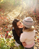 Two sisters in autumn forest — ストック写真