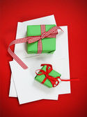 Christmas cards with Christmas presents — Stock Photo