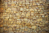 Background in the form of a wall from a granite stone — Stock Photo