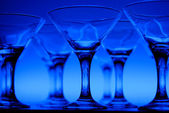 Wineglasses on the table in blue light — Stock Photo