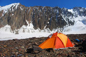 Orange tent in high mountains — Stock Photo