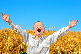 Boy in wheat field — Stock Photo
