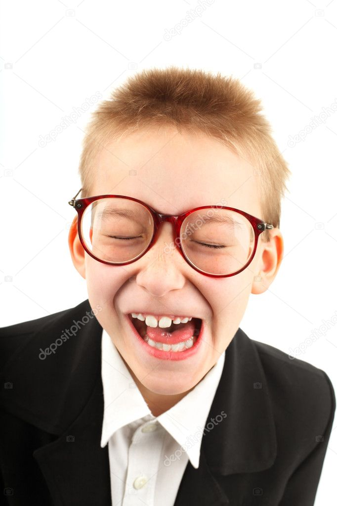 Seven years old boy grimacing and make funny face isolated on white  Stock Photo #5738676