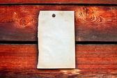 Blanco papier op houten achtergrond — Stockfoto