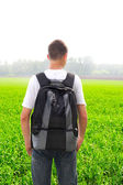 Teenager in the field — Stock Photo