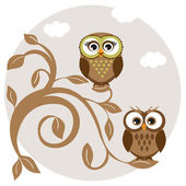 Cute owls couple on the tree — Stockfoto