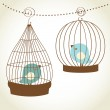 Vintage christmas card with two cute birds in the cages — Stock Photo