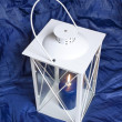 Antique white lantern with candle light - Stock Photo