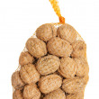 English walnuts wrapped in a mesh bag - Stok fotoğraf