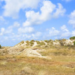 Clouds over summer dunes landscape — Stock Photo