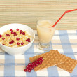 Breakfast consisting of yoghurt with cereal, fruit juice and  crisp bread — Stock Photo