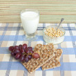 Healthy breakfast with milk, cereal, muesli bars, fresh grapes — Stock Photo
