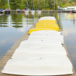 White and yellow punts on pier — Stock Photo