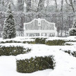 White bench in park in winter — Stock Photo