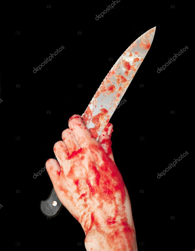 Hand holding kitchen knife covered in crushed tomatoes, resembling blood and flesh, isolated over black — Stock Photo #6705016