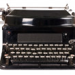 Old typewriter isolated on white background - Stok fotoraf
