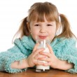 Stock Photo: The little girl with a milk glass