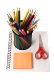 Set of pencils on a writing-book — Stock Photo
