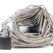 Stock Photo: Pile of newspapers with chains
