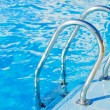 Ladder in pool with a handrail — Lizenzfreies Foto