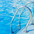 Foto Stock: Ladder in pool with handrail