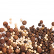 Peppercorns isolated on a white background — Stock Photo