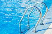 Ladder in pool with a handrail — Stock Photo