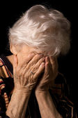 Portrait of the old woman a black background — Stock Photo