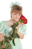 The little girl with a bouquet of roses — Stock Photo